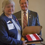 Mary Kuykendall receives flag for Realtor Day at the statehouse